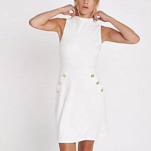 Mini-robe en maille point de Rome blanche à boutons sur le côté