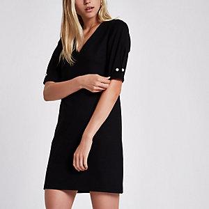 Schwarzes Swing-Kleid mit Perlenverzierung