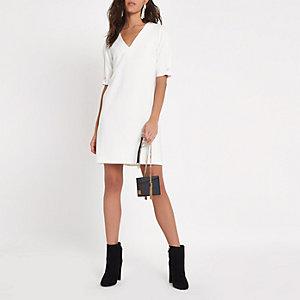 White short sleeve v neck swing mini dress