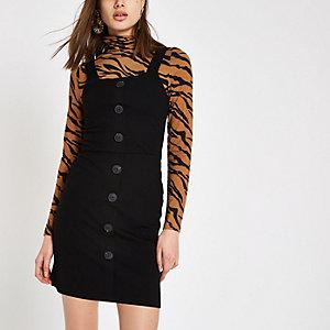Mini-robe moulante noire boutonnée