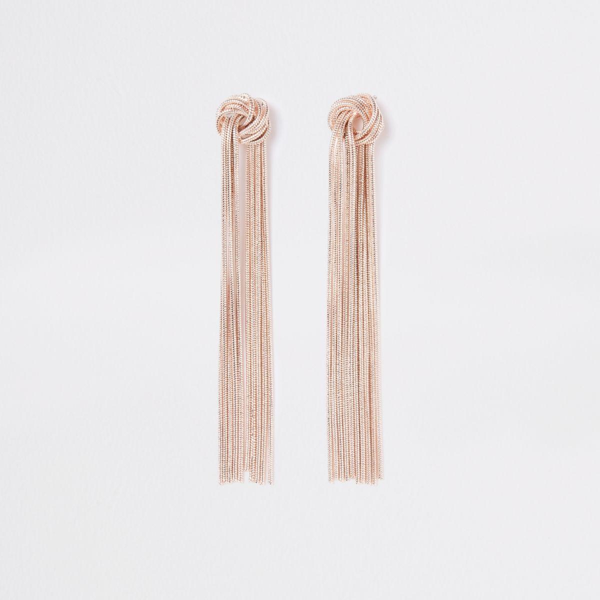 Gold tone slinky knot drop earrings