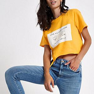 Geel cropped T-shirt met 'females of the future'-print