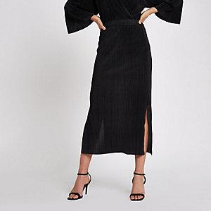 Jupe mi-longue noire plissée
