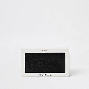 Schwarze Ledergeldbörse in Geschenkverpackung