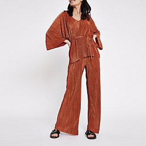 Roestbruine jersey broek met wijde plissé pijpen
