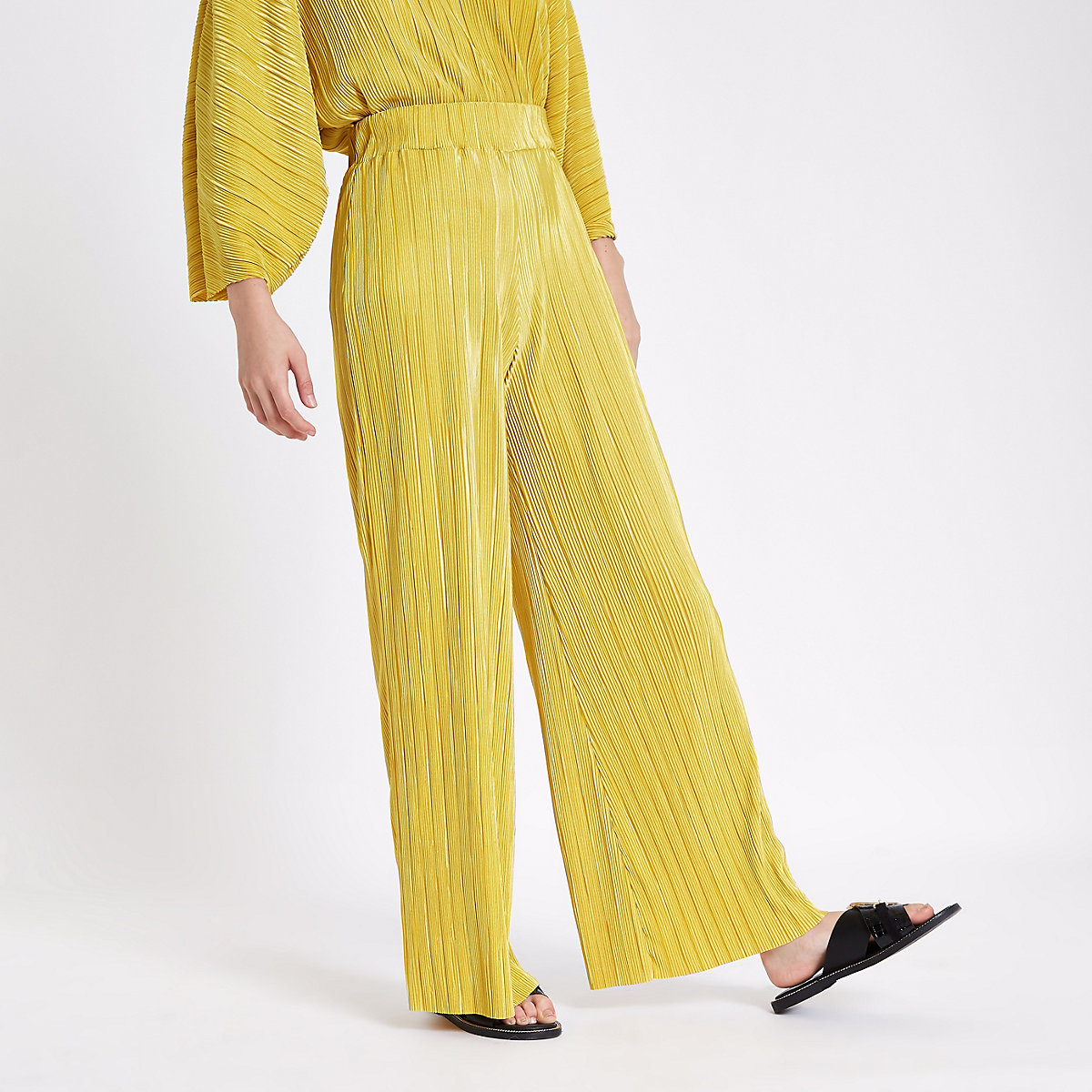 Yellow pleated jersey wide leg pants