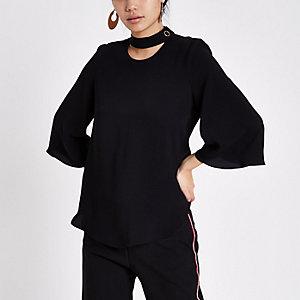 Black button neck blouse