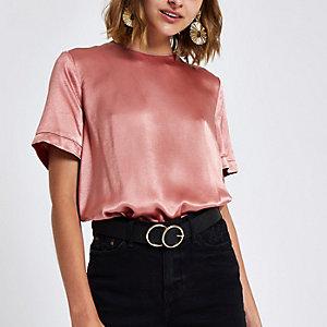 Roze ruimvallend T-shirt met rits op de rug