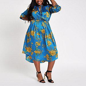 RI Plus - Blauwe gesmokte midi-jurk met print en strik bij de hals