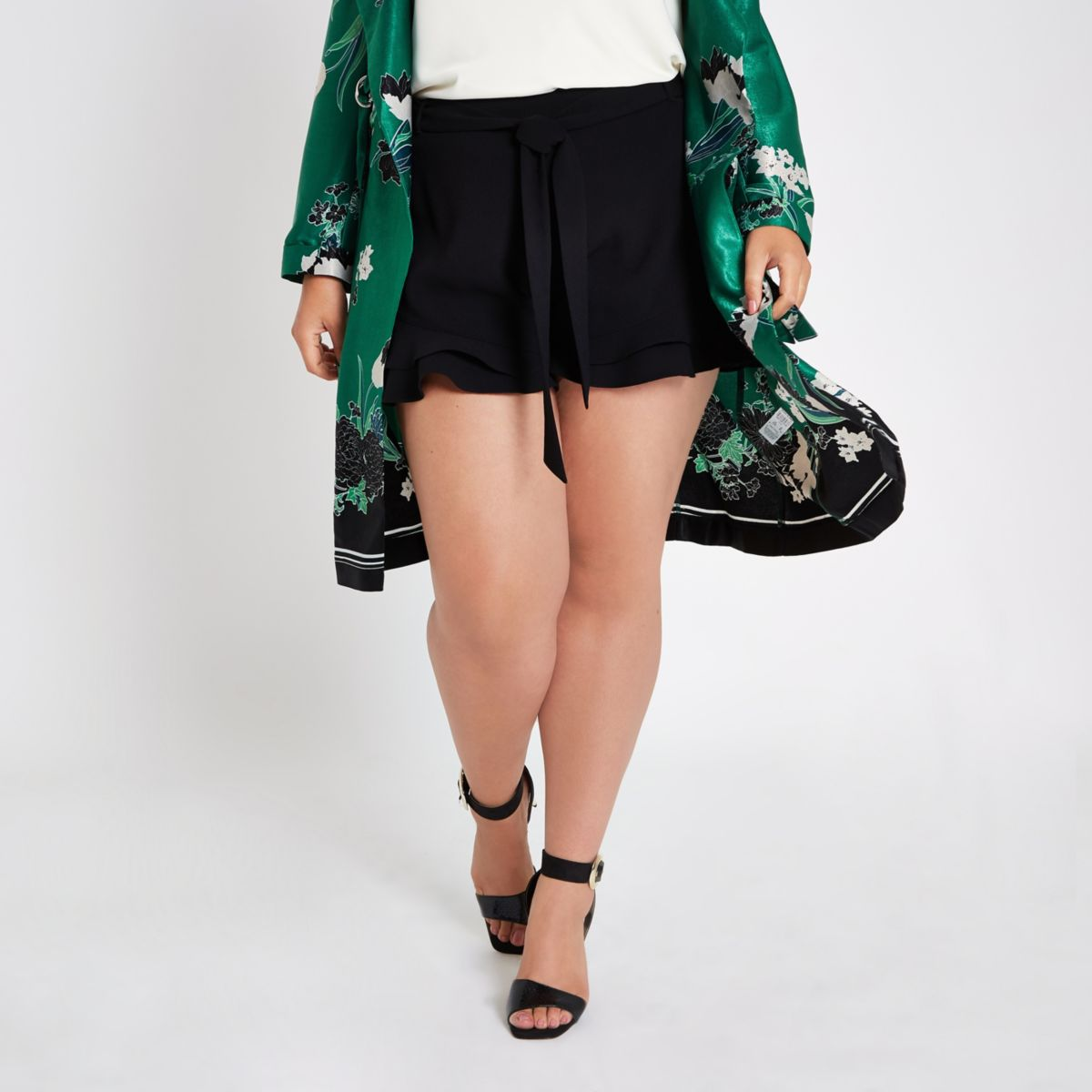 Plus black frill hem tie waist shorts