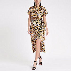 Robe mi-longue imprimé léopard jaune nouée à la taille