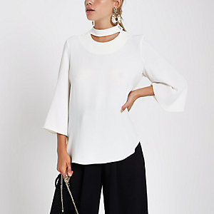 Cream button neck long sleeve top
