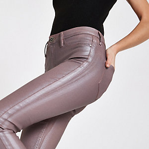 Light pink Molly mid rise coated skinny jeans