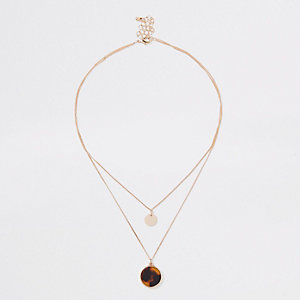 Gold tone black and yellow circle necklace