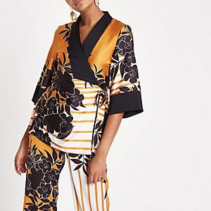 Oranje kimonotop met overslag en print