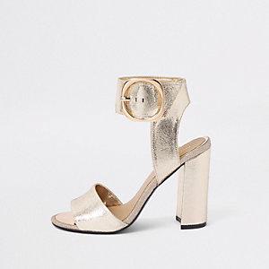 Goudkleurige metallic sandalen met blokhak en brede pasvorm