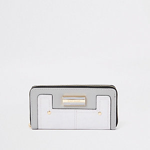 Porte-monnaie gris clair zippé à empiècements variés