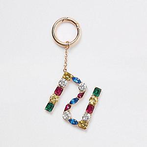 Porte-clés RI doré avec pierres fantaisie