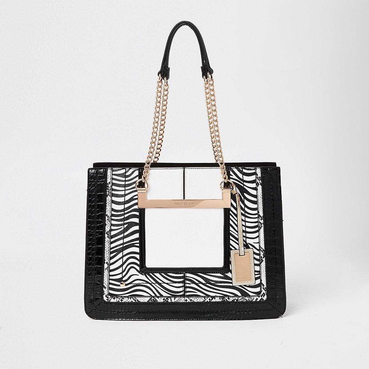 White zebra print chain handle tote bag