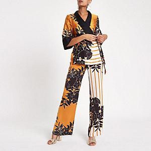 Orange Hose mit weitem Beinschnitt und Blumenprint