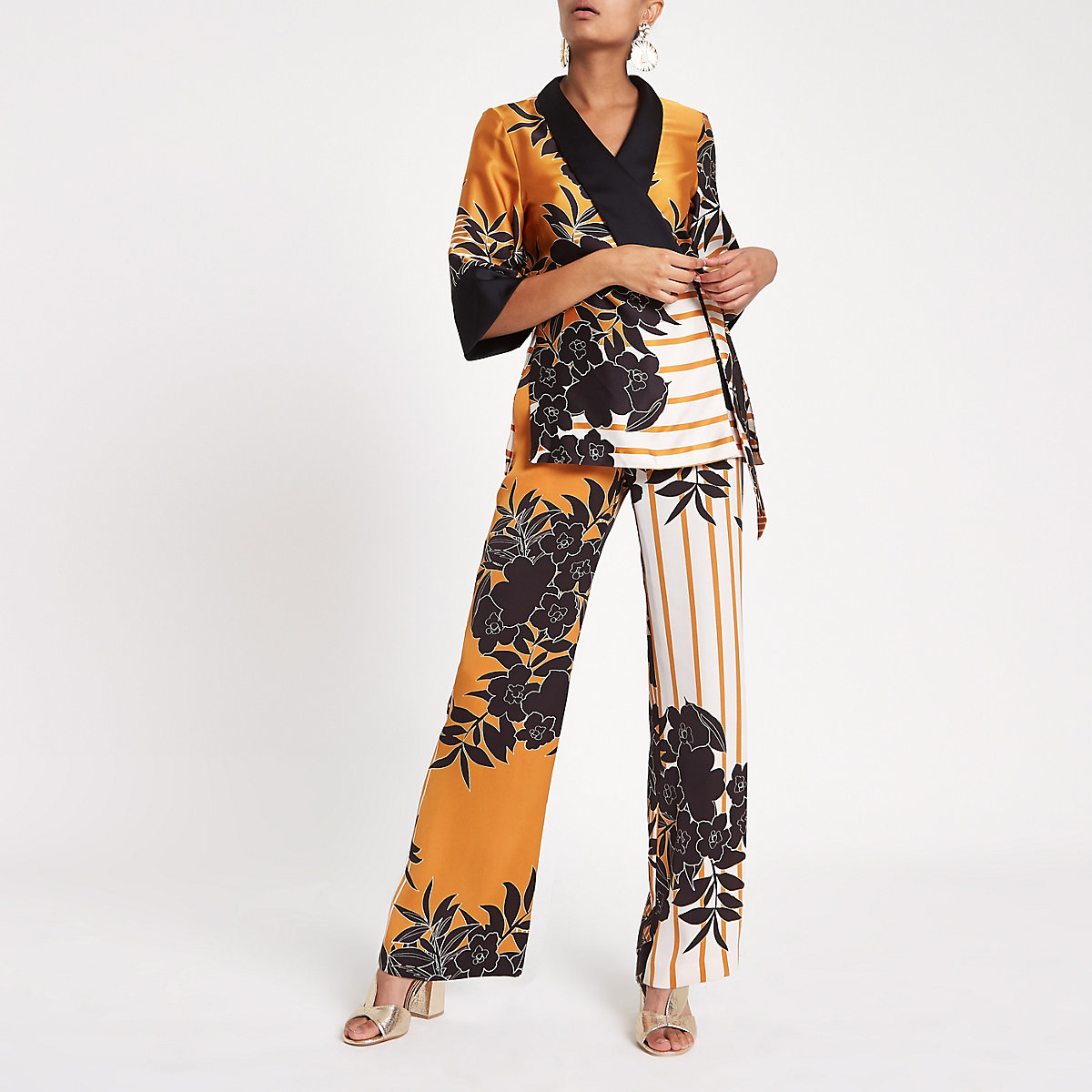 Orange floral print wide leg trousers