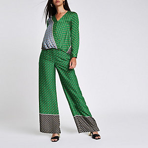 Green tile print wide leg trousers