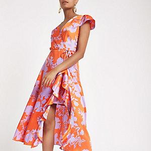 Rode midi-jurk met bloemenprint, ruches en overslag voor