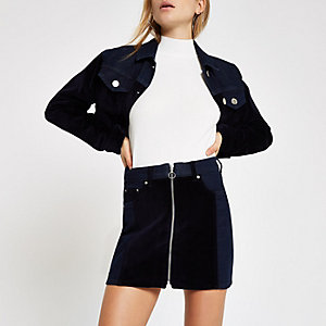Mini-jupe en denim bleu foncé zippée avec empiècements en velours