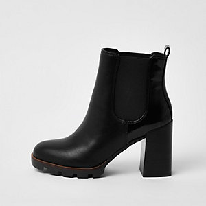Black cleated sole chelsea boots