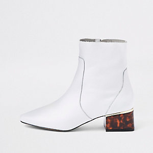 White leather tortoise shell block heel boots