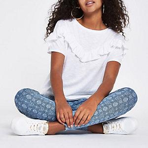 T-shirt blanc avec plastron à volants et manches courtes
