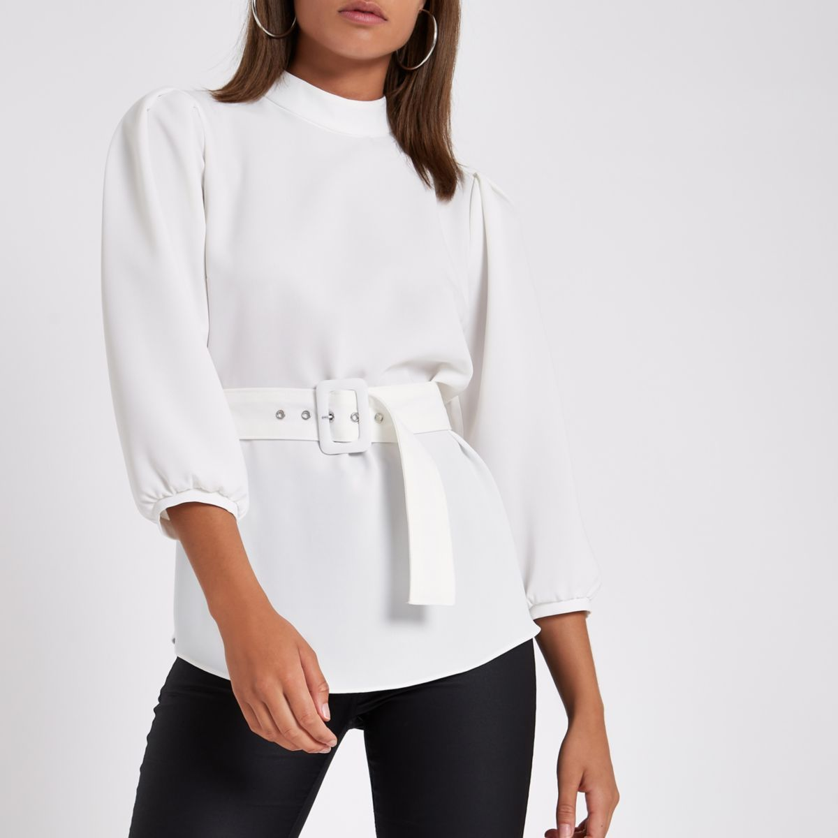 White loose fit cuffed hem belted top