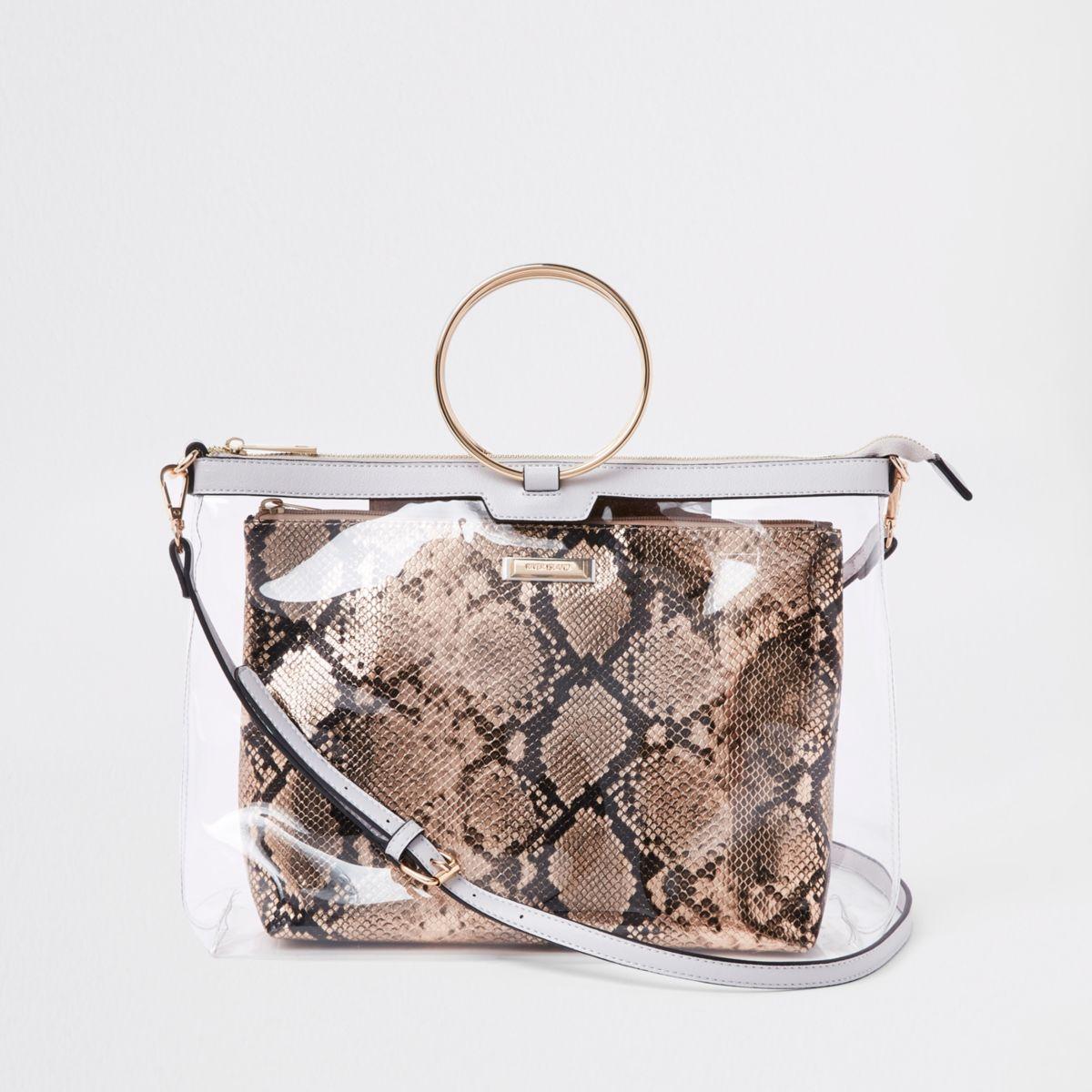 Gold tone ring handle perspex bag