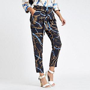 Pantalon fuselé imprimé chaîne bleu noué à la taille
