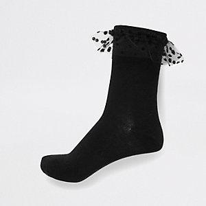 Zwarte gebreide sokken van mesh met ruches en kabelmotief