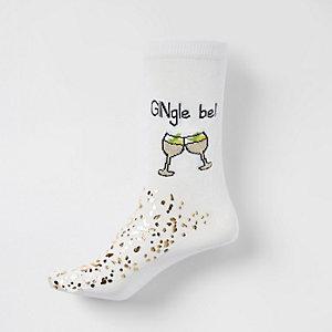 Crème sokken met 'gingle bells'-print