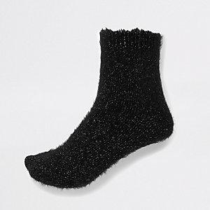 Chaussettes duveteuses noires à paillettes