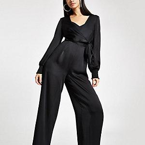 Zwarte jumpsuit met overslag, strikceintuur en wijde pijpen