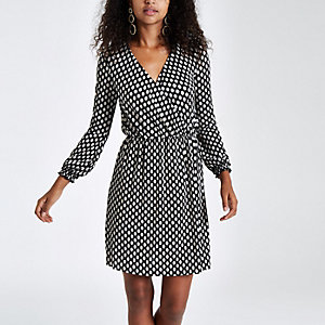 Black spot print plisse wrap front mini dress