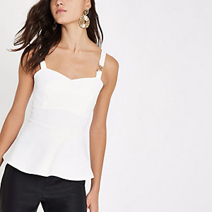 White peplum hem buckle strap top