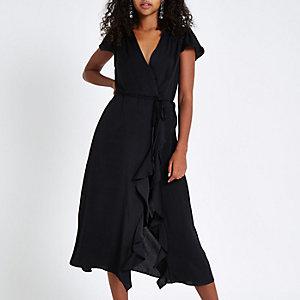 Zwarte midi-jurk met ruches en overslag voor