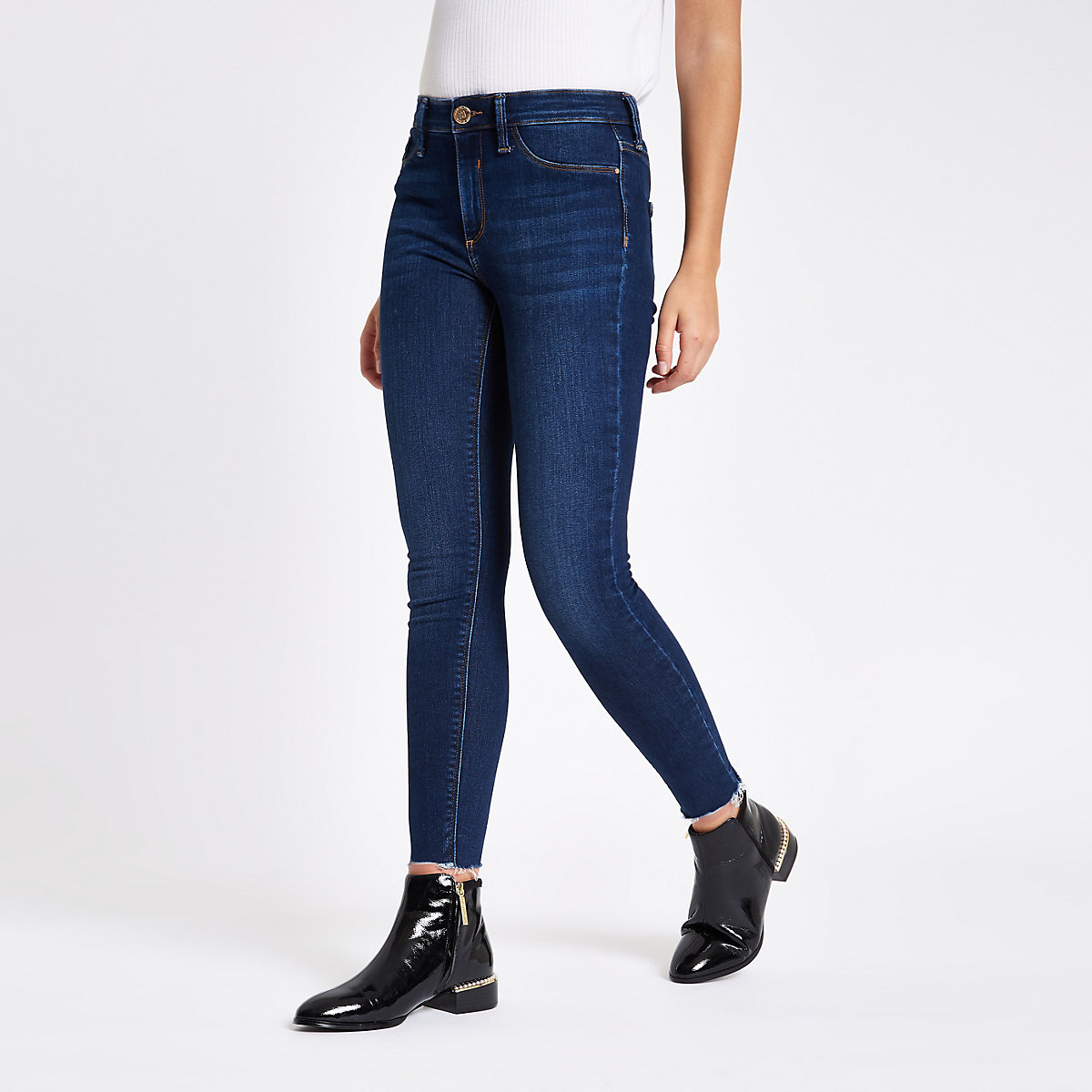 Dark blue mid rise raw hem Molly jeggings