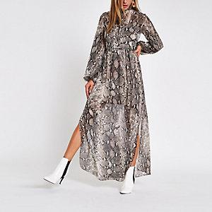Beige maxi-jurk met slangenprint en strikceintuur