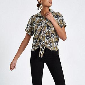 Chemise noire à imprimé feuille nouée sur le devant
