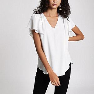Witte ruimvallende blouse met V-hals