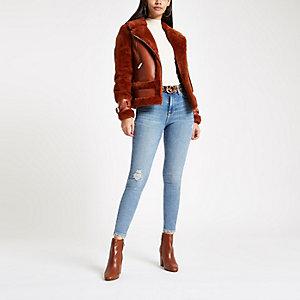 Jean skinny bleu moyen taille haute style 80's