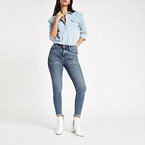 Dunkelblaue Skinny Jeans mit hohem Bund im 80er-Look