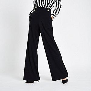 Zwarte broek met elastiek, dubbele knoop en wijde pijpen