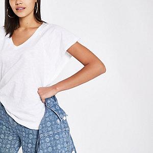 T-shirt ample blanc à col en V et manches chauve-souris