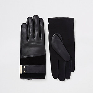 Black leather gold tone gloves
